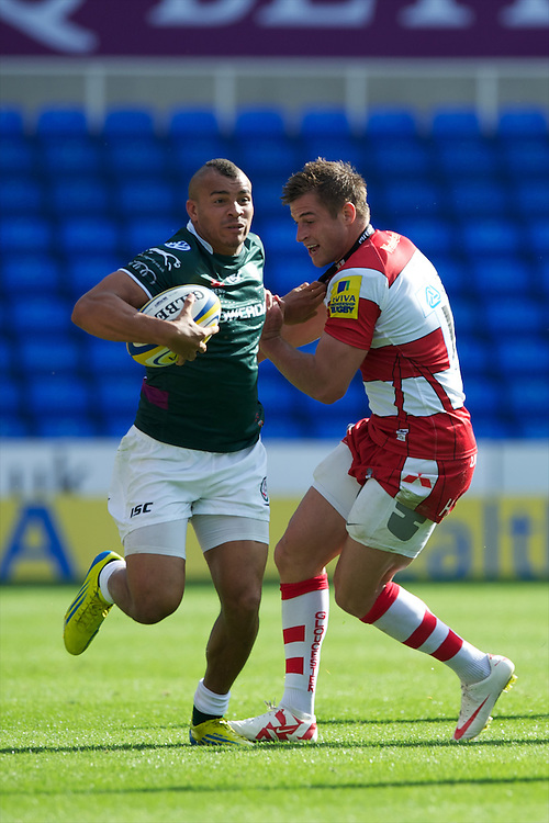 Jonathan Joseph of London Irish brushes off Freddie Burns of Gloucester Rugby during the Aviva Premiership match between London Irish and Gloucester Rugby at the Madejski Stadium on Saturday 8th September 2012 (Photo by Rob Munro)