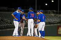AZL Cubs starting pitcher Alfredo Colorado (75) is visited by the infielders and the pitching coach during the game against the AZL Diamondbacks on August 11, 2017 at Sloan Park in Mesa, Arizona. AZL Cubs defeated the AZL Diamondbacks 7-3. (Zachary Lucy/Four Seam Images)