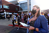 Madison Barnes (right), English and year book teacher at Bentonville High School, says the Pledge of Allegiance on Tuesday Sept. 7 2021 with students at the school's 9-11 remembrance ceremony. Go to nwaonline.com/210911Daily/ to see more photos.<br />(NWA Democrat-Gazette/Flip Putthoff)