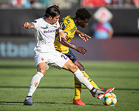 CHARLOTTE, NC - JULY 20: Lorenzo Venuti #2 and Bukayo Saka #77 go for the ball during a game between ACF Fiorentina and Arsenal at Bank of America Stadium on July 20, 2019 in Charlotte, North Carolina.