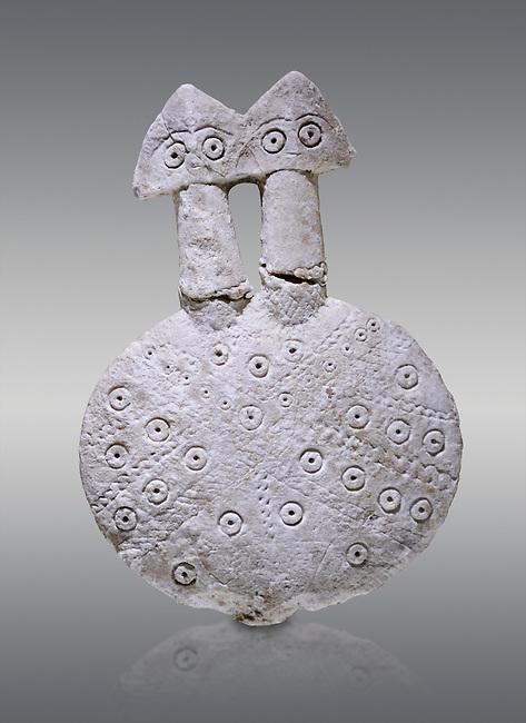 Bronze Age Anatolian two headed disk shaped alabaster Goddess figurine - 19th to 17th century BC - Kültepe Kanesh - Museum of Anatolian Civilisations, Ankara, Turkey. Against a grey background.