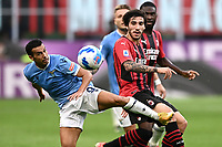 Pedro Rodriguez Ledesma of SS Lazio and Sandro Tonali of AC Milan compete for the ball during the Serie A 2021/2022 football match between AC Milan and SS Lazio at Giuseppe Meazza stadium in Milano (Italy), August 29th, 2021. Photo Image Sport / Insidefoto