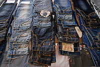 BANGLADESH , textile industry in Dhaka , Beximco textile factory produce Jeans for export for western discounter, showroom for clients / Bangladesch , Beximco Textilfabrik in Dhaka produziert Jeans fuer den Export fuer westliche Textildiscounter, Showroom fuer Kunden