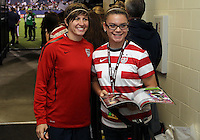 BOCA RATON, FL - DECEMBER 15, 2012: Amy LePeilbet (6 of the USA WNTsigns autographs at the end of an international friendly match against China at FAU Stadium, in Boca Raton, Florida, on Saturday, December 15, 2012. USA won 4-1.