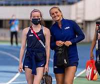 TOKYO, JAPAN - JULY 20: Rose Lavelle #16 and Lindsey Horan #9 of the USWNT walk onto the field before a training session at the practice fields on July 20, 2021 in Tokyo, Japan.