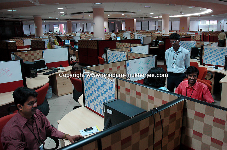 Indian Software professionals at work in Infosys, Bangalore. Infosys is the largest software company in the country and the head office is in Bangalore, Karnataka, India. Arindam Mukherjee
