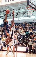 WASHINGTON, DC - NOVEMBER 16: Sherwyn Devonish #5 of Morgan State shoots over Shawn Walker Jr. #1 of George Washington during a game between Morgan State University and George Washington University at The Smith Center on November 16, 2019 in Washington, DC.