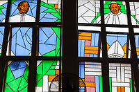 Nigeria. Enugu State. Enugu. St. Theresa's Parish. Catholic Church. Colorful stained glasses with portraits of Reverend Father Anthony Aso (L),  the first Parish priest, and Pope Francis (R). Pope Francis ( born Jorge Mario Bergoglio;17 December 1936) is the head of the Catholic Church and sovereign of the Vatican City State. Francis is the first Jesuit pope and  the first from the Americas. Enugu is the capital of Enugu State, located in southeastern Nigeria. 30.06.19 © 2019 Didier Ruef