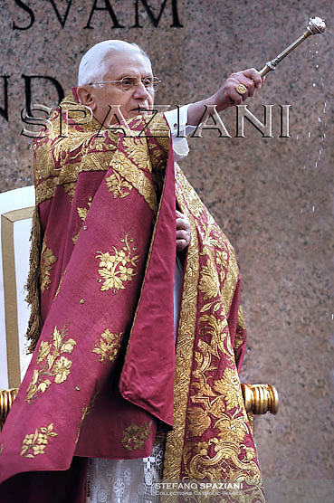 Pope Benedict XVI benedicts faithful during an open-air Palm Sunday mass in St. Peter's square at the Vatican Sunday, March 16, 2008.