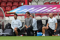 Brentford Manager, Thomas Frank, takes a knee ahead of kick-off during Brentford vs Wigan Athletic, Sky Bet EFL Championship Football at Griffin Park on 4th July 2020