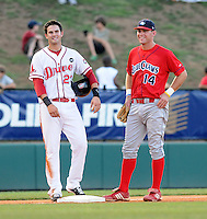 July 29, 2009: Casey Kelly (23) of the Greenville Drive, a top Boston Red Sox pitching prospect now playing shortstop, chats with Lakewood BlueClaws third baseman Travis Mattair (14) during a break in the action  in a game at Fluor Field at the West End in Greenville, S.C. Photo by: Tom Priddy/Four Seam Images