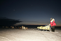 Mitch Seavey leaves from the slough as the sun begins to rise on Monday morning at Unalakleet,  2005 Iditarod Trail Sled Dog Race.