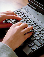 Woman's hands on keyboard of laptop computer. computers, typing. H. Bruce, M.R. H-1.