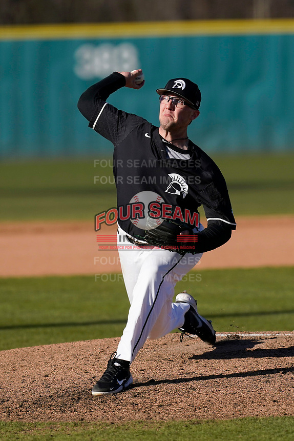 Austin Morgan (10) of the University of South Carolina Upstate Spartans delivers a pitch in a 5-1 win against the University of Toledo Rockets on Saturday, February 20, 2021, at Cleveland S. Harley Park in Spartanburg, South Carolina. (Tom Priddy/Four Seam Images)