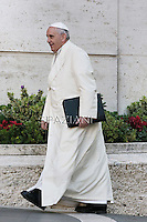 Pope Francis arrives for the Papal consistory before the nominations of new cardinals, at the Vatican on February 13, 2015.