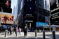 NEW YORK, NEW YORK - MARCH 10: People walk around Nasdaq building at Times Square on March 10, 2021, in New York. The Nasdaq Composite continued falling more than half a percent during the day also the move away from Apple Inc, Amazon.com Inc , Facebook Inc, Tesla Inc and Microsoft Corp, falling during the day, helped small-cap stocks rise more than double the gains of the S&P 500. (Photo by John Smith/VIEWpress)
