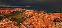 904000038 panoramic view of two bolts of lightning striking the aquarius plateau and the hoodoos of bryce canyon national park during a summer monsoon rainstorm with ominous clouds in the background in utah united states