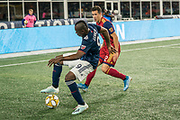 FOXBOROUGH, MA - SEPTEMBER 21: Juan Fernando Caicedo #9 of New England Revolution controls the ball as Brooks Lennon #12 of Real Salt Lake comes in to tackle during a game between Real Salt Lake and New England Revolution at Gillette Stadium on September 21, 2019 in Foxborough, Massachusetts.