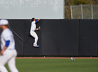 IMG Academy Ascenders Sam Felner (13) attempts to catch a home run during a game against the Victory Charter School Knights on February 28, 2020 at IMG Academy in Bradenton, Florida.  (Mike Janes/Four Seam Images)