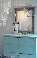 An old chest of drawers in one of the bedrooms has been given a new lease of life with a lick of turquoise paint and a few Christmas decorations