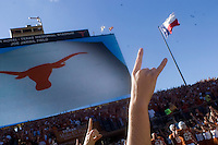 24 November 2006: A cheerleader's hand flashes a hook 'em horns hand sign as the Longhorns take the field before their 12-7 loss to the Texas A&M Aggies at Darrell K Royal Memorial Field in Austin, TX.