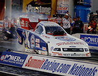 Apr 7, 2006; Las Vegas, NV, USA; NHRA Funny Car racer Robert Hight does a burnout in Auto Club Ford Mustang during qualifying for the Summitracing.com Nationals at Las Vegas Motor Speedway in Las Vegas, NV. Mandatory Credit: Mark J. Rebilas