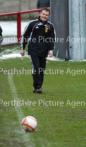 Brechin v St Johnstone....12.03.11  Scottish Cup Quarter Final.Ref Steve Conroy tests the pitch.Picture by Graeme Hart..Copyright Perthshire Picture Agency.Tel: 01738 623350  Mobile: 07990 594431