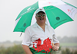 A patriotic Welsh fan enjoying the golf in the rain<br /> <br /> Golf - Day 2 - ISPS Handa Wales Open 2014 - Twenty Ten Course- Friday 19th September 2014 - Celtic Manor Resort  - Newport<br /> <br /> © www.sportingwales.com- PLEASE CREDIT IAN COOK