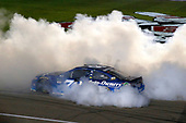 Monster Energy NASCAR Cup Series<br /> Go Bowling 400<br /> Kansas Speedway, Kansas City, KS USA<br /> Saturday 13 May 2017<br /> Martin Truex Jr, Furniture Row Racing, Auto-Owners Insurance Toyota Camry celebrates his win with a burnout <br /> World Copyright: Russell LaBounty<br /> LAT Images<br /> ref: Digital Image 17KAN1rl_5721