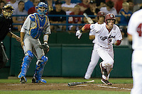South Carolina OF Evan Marzilli heads to first during Game Two of the NCAA Division One Men's College World Series Finals on June 29th, 2010 at Johnny Rosenblatt Stadium in Omaha, Nebraska.  (Photo by Andrew Woolley / Four Seam Images)