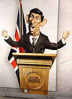 Caricature of Chancellor Rishi Sunak on large advertisement board for satirical television puppet show Spitting Image inside Westminster Tube Station. London September 30th 2020<br /> <br /> Photo by Keith Mayhew