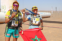8th October 2021; Boulchrhal to Sud Jebel Irhfelt N'Tissalt ; Marathon des Sables, stage 5 and final stage of a six-day, 251 km ultramarathon, which is approximately the distance of six regular marathons. The longest single stage is 91 km long. This multiday race is held every year in southern Morocco, in the Sahara Desert. Aziz Raji (mor)  as ladies winner with compatriot HAMDOUCH Hassna (Mor)