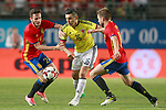 Spain's Saul Niguez (l) and Asier Illarramendi (r) and Colombia's Daniel Torres during international friendly match. June 7,2017.(ALTERPHOTOS/Acero)