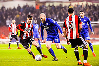 Cardiff City's midfielder Aron Gunnarsson (17)  goes past Sheffield United's midfielder Lee Evans (20) during the Sky Bet Championship match between Sheff United and Cardiff City at Bramall Lane, Sheffield, England on 2 April 2018. Photo by Stephen Buckley / PRiME Media Images.