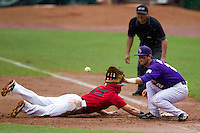 LSU Tigers first baseman Tyler Moore #2 catches a pick off attempt during the NCAA Super Regional baseball game against Stony Brook on June 9, 2012 at Alex Box Stadium in Baton Rouge, Louisiana. Stony Brook defeated LSU 3-1. (Andrew Woolley/Four Seam Images)