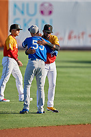 Gavin Lux (55) of the Oklahoma City Dodgers and Jo Adell (26) of the Salt Lake Bees greet each other before the game at Smith's Ballpark on August 1, 2019 in Salt Lake City, Utah. The Bees defeated the Dodgers 14-4. (Stephen Smith/Four Seam Images)