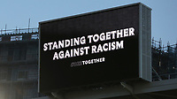 The Big Screen at the top of the Main Stand displays a message, Standing Together Against Racism during Brentford vs Birmingham City, Sky Bet EFL Championship Football at the Brentford Community Stadium on 6th April 2021