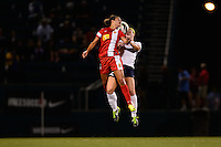 Western New York Flash midfielder Carli Lloyd (10) goes up for a header with Sky Blue FC midfielder Ashley Nick (12). The Western New York Flash defeated Sky Blue FC 2-0 during a National Women's Soccer League (NWSL) semifinal match at Sahlen's Stadium in Rochester, NY, on August 24, 2013.