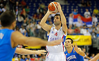 Serbia's Milos Teodosic shoots the ball during European championship group B basketball match between Serbia and Italy on 10. September 2015 in Berlin, Germany  (credit image & photo: Pedja Milosavljevic / STARSPORT)