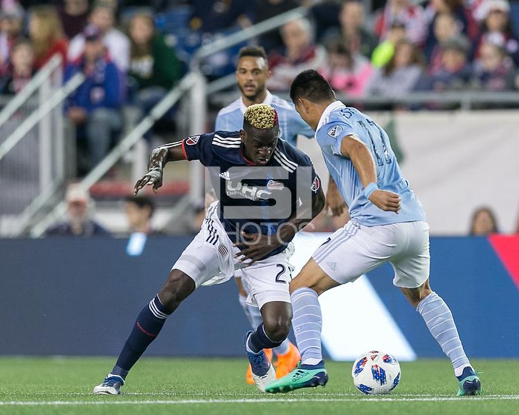Foxborough, Massachusetts - April 28, 2018: First half action. In a Major League Soccer (MLS) match, New England Revolution (blue/white) vs Sporting Kansas City (light blue/white), at Gillette Stadium.