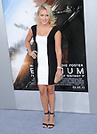Emily Osment at The TriStar Pictures' World Premiere of Elysium held at The Regency Village Theatre in Westwood, California on August 07,2013                                                                   Copyright 2013 Hollywood Press Agency