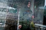 Tanya, Scharfschuetzin der pro-russischen Separatisten, Portrait, Donezk, Ukraine, 10.2014,  Tanya, 19-years old girl, the sniper of the pro-Russian militia smokes in the corridor of her unit based at the suburb of Donetsk.  ***HIGHRES AUF ANFRAGE*** ***VOE NUR NACH RUECKSPRACHE***