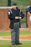 Home plate umpire Mike Cafaro makes notes after issuing a warning to the High Point Panthers bench during the game against the Liberty Flames at Willard Stadium on March 23, 2013 in High Point, North Carolina.  The Panthers defeated the Flames 9-3.  (Brian Westerholt/Four Seam Images)