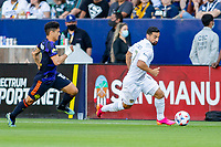 CARSON, CA - JUNE 19: Sebastian Lletget #17 of the Los Angeles Galaxy is chased down by Fredy Montero #12 of the Seattle Sounders FC during a game between Seattle Sounders FC and Los Angeles Galaxy at Dignity Health Sports Park on June 19, 2021 in Carson, California.