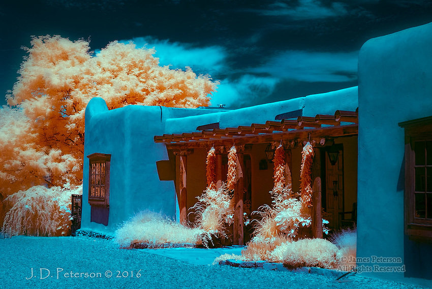 """Ristras, Canyon Road, Santa Fe (Infrared) ©2016 James D Peterson.  Classic New Mexico themes get a new look in infrared light.  Limited Edition - Call Jim at 928-554-4340 for current availability.<br /> <br /> This image was selected for the """"Seeing Blue"""" exhibit at Gallery 25N."""