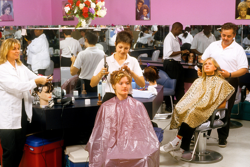 College student working on hair and cosmetology with teachers and students acting as client