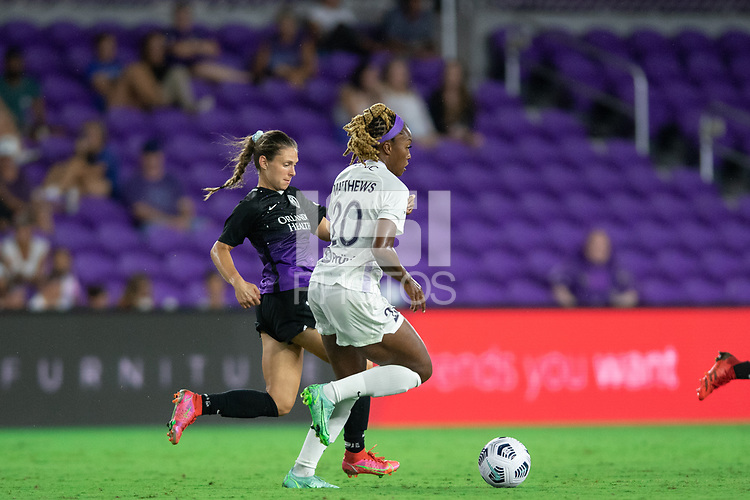 ORLANDO, FL - SEPTEMBER 11: Marisa Viggiano #14 of the Orlando Pride and Cheyna Matthews #20 of Racing Louisville FC battle for the ball during a game between Racing Louisville FC and Orlando Pride at Exploria Stadium on September 11, 2021 in Orlando, Florida.