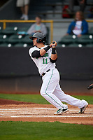 Clinton LumberKings catcher Yojhan Quevedo (11) follows through on a swing during a game against the Lansing Lugnuts on May 9, 2017 at Ashford University Field in Clinton, Iowa.  Lansing defeated Clinton 11-6.  (Mike Janes/Four Seam Images)