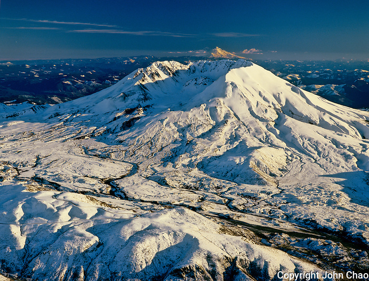 Aerial of Mount Saint Helens in winter, with Mount Hood in background, Washington State