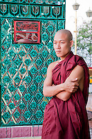 Myanmar, Burma.  Sutaungpyei Pagoda, Mandalay Hill Temple.  Young Burmese Monk.